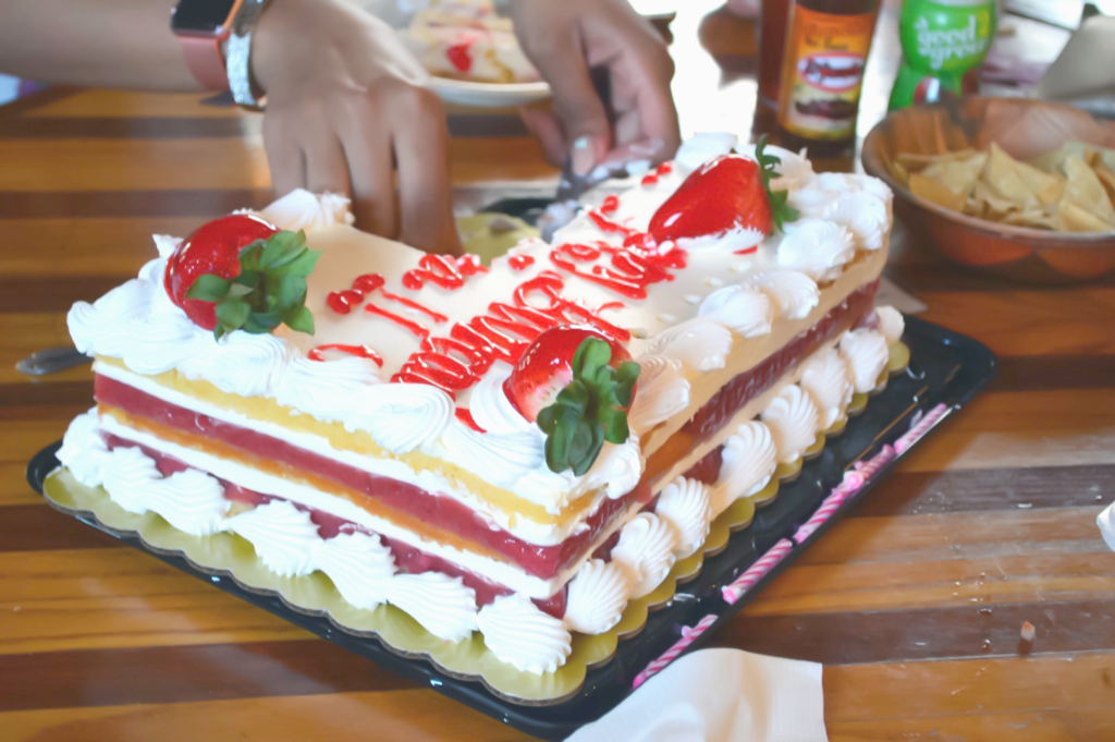 portion controlling the strawberry cake to maintain healthy habits while eating out