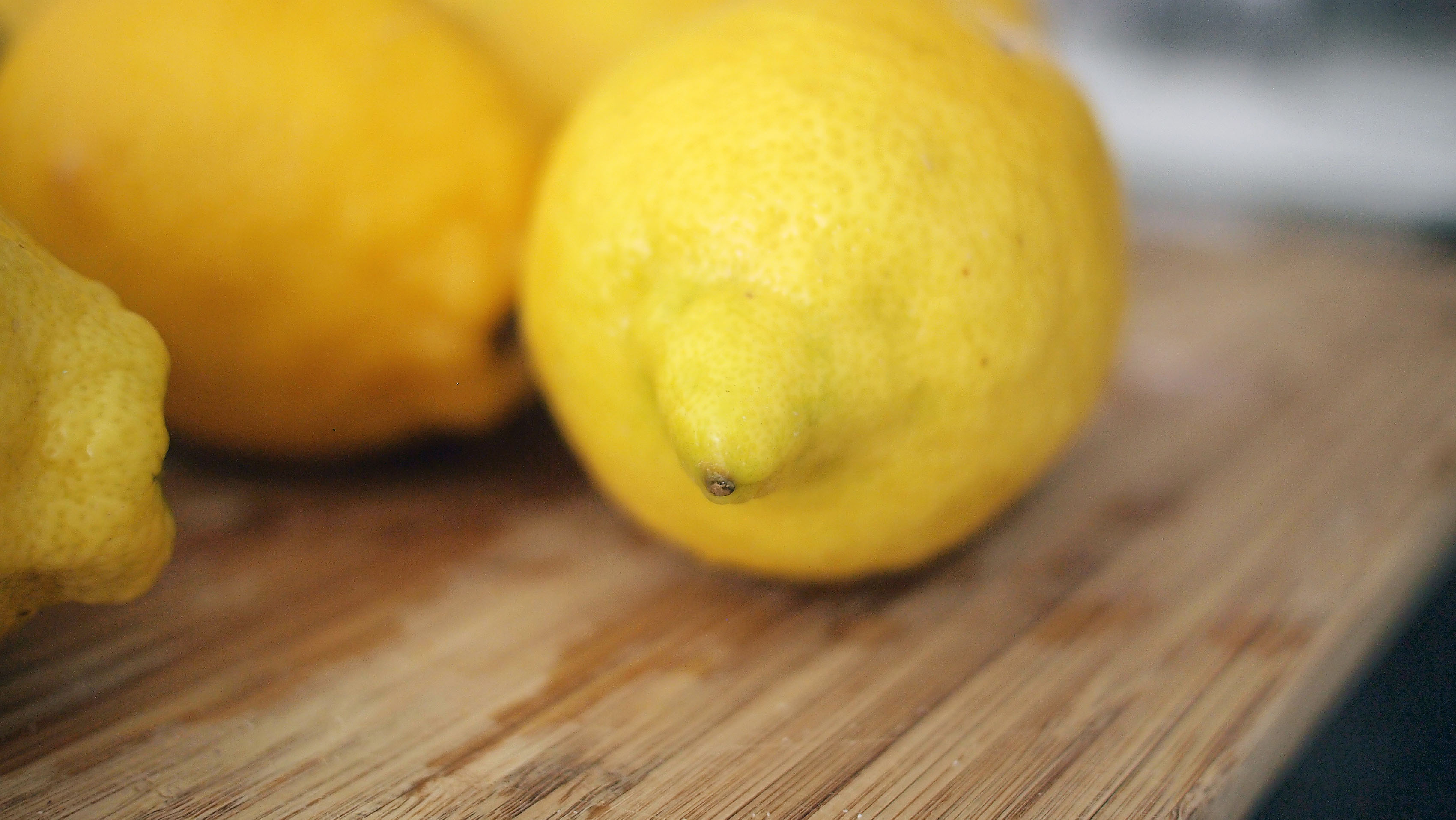 lemons on a cutting board for lemon water